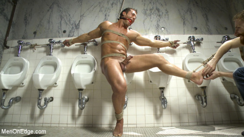 Gay BDSM College jock gets a crash course in edging while bound to the urinals