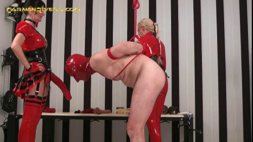 Femdom and Strapon Domina in red latex ready to please