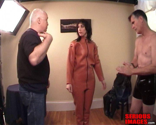 bdsm SI - Zoie in a blow up orange heavy rubber catsuit
