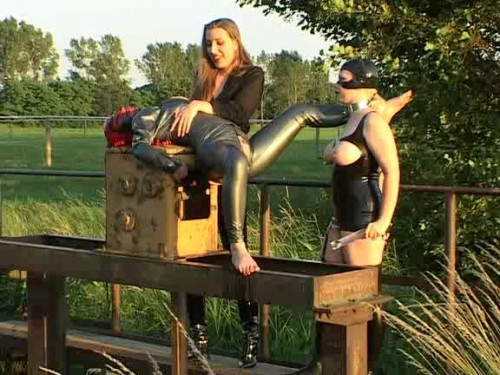 Femdom and Strapon Lesbian in latex fuck in nature