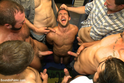 A mob of men punish a thief with a giant cock