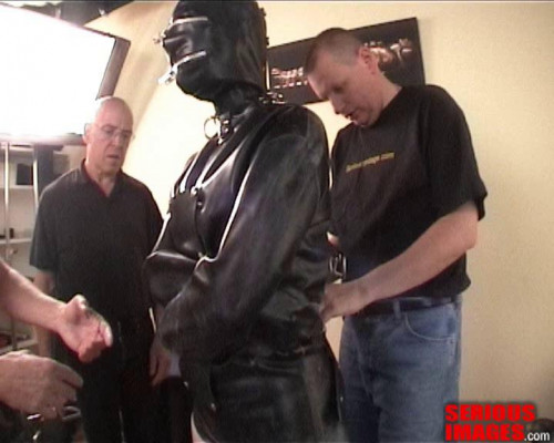 bdsm Zoie in a heavy rubber strait jacket