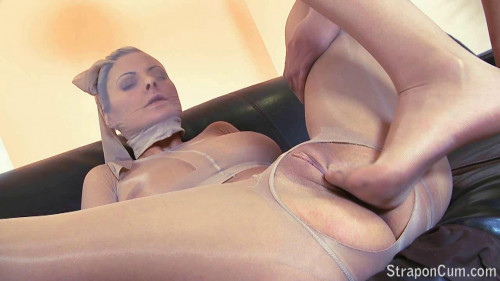 Femdom and Strapon Punishment for a pantyhose doll