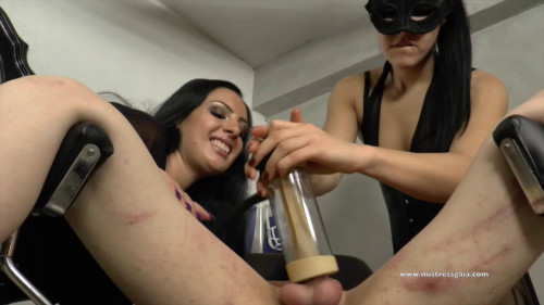 Femdom and Strapon Impotent slave tormented with the milking machine