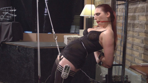 Roswell Ivory hangs her key on the hand of a clock on the wall... (2014) BDSM