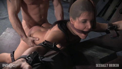 India Summer's is strapped to and 'X' frame