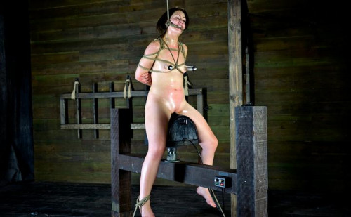 A unique rope gag holds our Girl Next Door in place BDSM