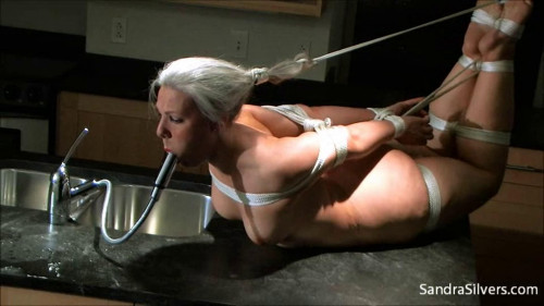 Bondage, hogtie and water torture on the table BDSM