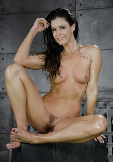 Fit sexy MILF India Summer shackled down and used hard by two cocks