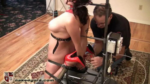 Naked Gord sexy silk dress, fishnet pantyhose and open toed high heels BDSM