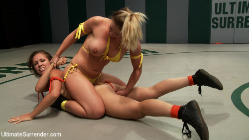 Blond Fitness model & gorgeous brunette battle it out on the mat. Loser gets fucked, must lick pussy Femdom and Strapon