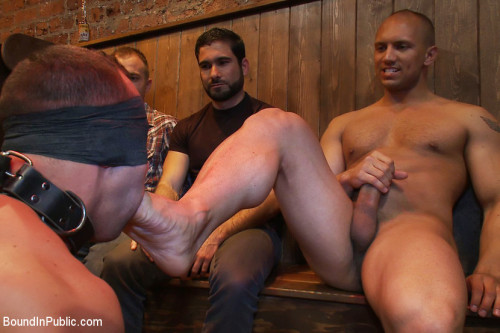 Gay BDSM Italian bodybuilder is used and humiliated at a public bar.