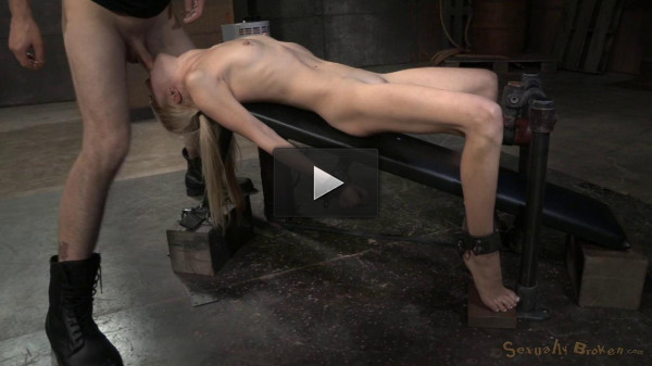 Petite deepthroat champ Odette Delacroix shackled to fucking machine and facefucked by hard cock!