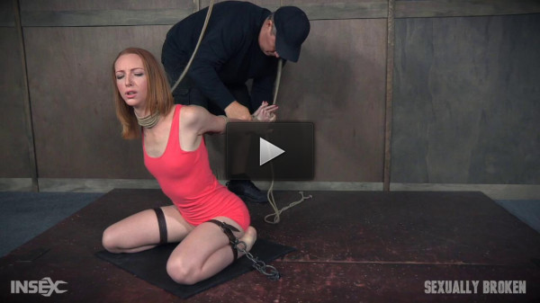 Katy Kiss the sexy tall redhead, is severely bound...