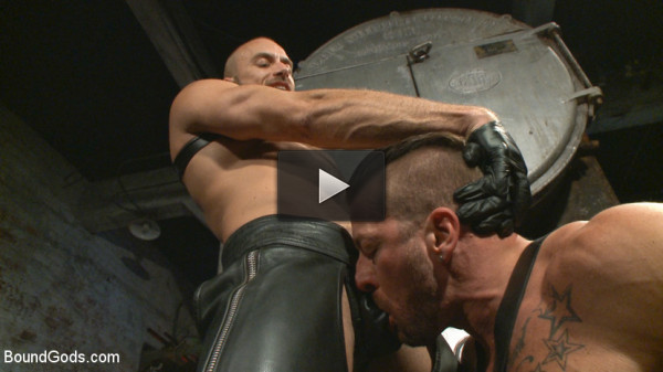 Cock hungry leather studs play in a dark basement.
