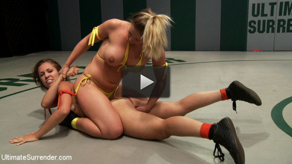 Blond Fitness model & gorgeous brunette battle it out on the mat. Loser gets fucked, must lick pussy