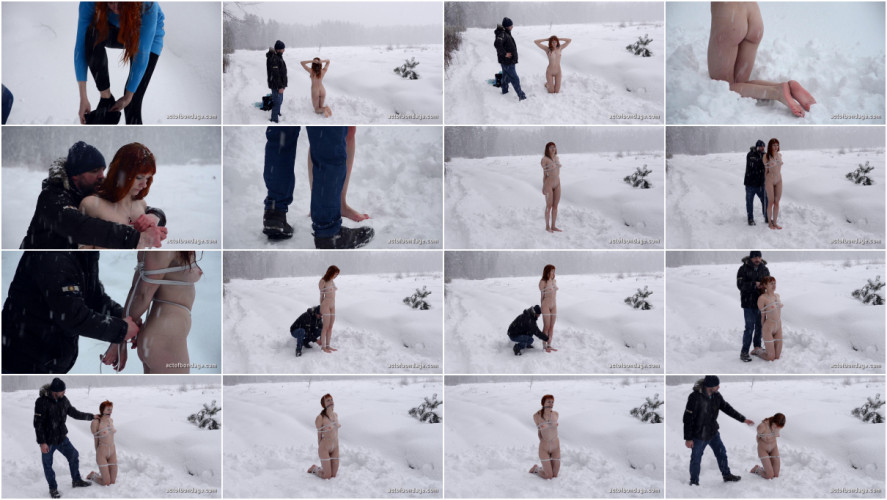 BDSM Redhead beauty strips naked for bondage in the snow