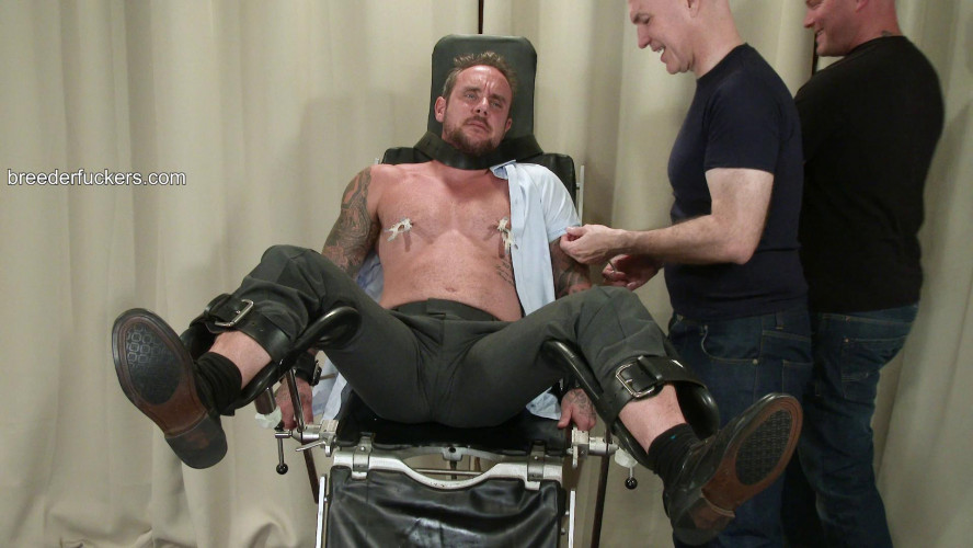 Gay BDSM Ian - Strapped to a gyno bench, clothes shredded