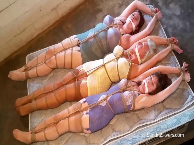 BDSM A Trio of Struggling Girdle Bound Damsels in Distress Stretched