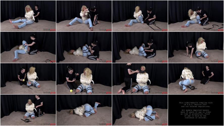 BDSM Lydia Watches Megan Jones Helpless in Straitjacket