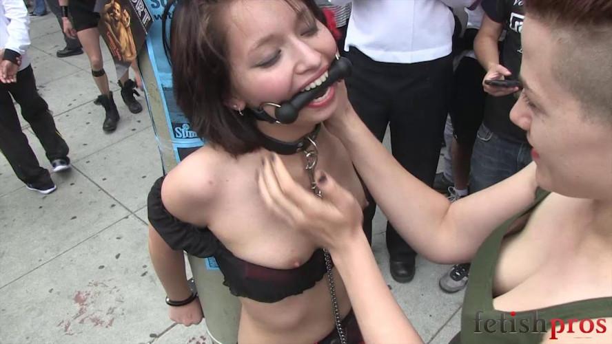 BDSM Ruby Handcuffed to Pole in Public