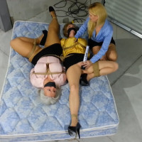 Blond Ladyboss Delivers Bondage Orgasms To Buxom MILF Secretaries In The Warehouse