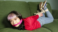 Raina In Jeans And Sofa