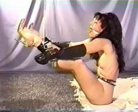 Suspended, Her Legs Are Then Tied With Rope For