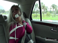 Corseted, Buxom, Bound And Big Ball-Gagged Real Estate Agent Sandra