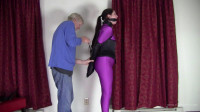 Paige Erin Turner – Purple Catsuit And Leather Armbinder