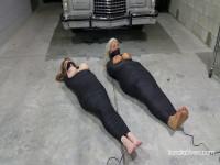Two Buxom Mummified MILFs Endure Agonizing Bondage Orgasms In The Auto Shop