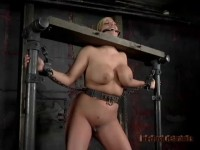 He Rolls Her Out For Display. Her Head Is Locked In Stocks, A Metal Gag