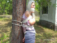 Two Milf Carried Over-the-Shoulder Into The Woods And Tied To A Tree