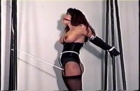 You Can See Her Standing Still As Her Captor Wraps Her Body With Ropes