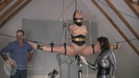 Legs spread wide. Gagged. Eyes tearing up from the intense bondage