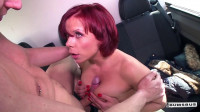 This tattooed German redhead is down for a blowjob and a titjob in the car