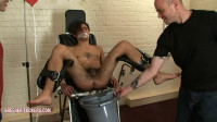 Tied naked to examination chair for Lucas