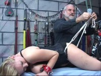 With full suspension bondage she is then lowered onto a board of nails