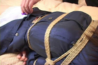 Cute and bound in the hogtie this asian beauty can really struggle