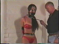 Youd see her looking very helpless while bound, gagged and seated on the couch