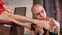 Mistress Mercedes enjoys controlling her lowly slave with her beautiful feet while verbally humiliati