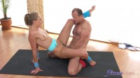 Flexible yoga girl stretched in gym