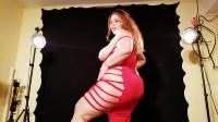 busty milf redhead in photo studio