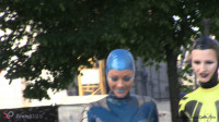 Through the city in a tight latex costume