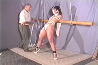 She's completely bound in rope and gagged