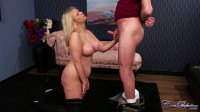 Dominatrix gives her slave a handjob