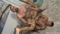 Experienced males caress a big dick
