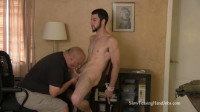 A bald man tied a bearded man to jerk his cock (540p)