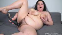 Sweety masturbates with her black vibrator