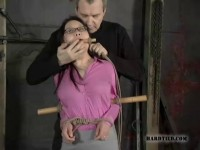 Tied to bamboo and half-dressed, Koan's manhandled, slapped